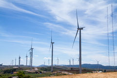 Power of wind turbine generating electricity clean energy with c. Loud background on the blue sky.Global ecology.Clean energy concept save the world stock images