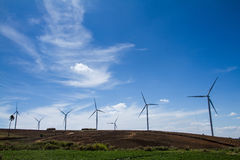 Power of wind turbine generating electricity clean energy with c. Loud background on the blue sky.Global ecology.Clean energy concept save the world royalty free stock photos
