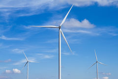 Power of wind turbine generating electricity clean energy with c. Loud background on the blue sky.Global ecology.Clean energy concept save the world Stock Photography