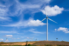 Power of wind turbine generating electricity clean energy with c. Loud background on the blue sky.Global ecology.Clean energy concept save the world stock photos
