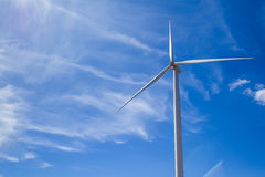 Power of wind turbine generating electricity clean energy with c. Loud background on the blue sky.Global ecology.Clean energy concept save the world royalty free stock images