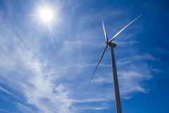 Power of wind turbine generating electricity clean energy with c. Loud background on the blue sky.Global ecology.Clean energy concept save the world royalty free stock photography