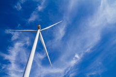 Power of wind turbine generating electricity clean energy with c. Loud background on the blue sky.Global ecology.Clean energy concept save the world royalty free stock image