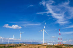 Power of wind turbine generating electricity clean energy with c. Loud background on the blue sky.Global ecology.Clean energy concept save the world royalty free stock photo