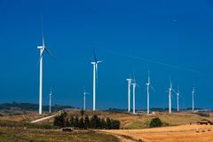 .Power of wind turbine generating electricity clean energy with cloud background on the blue sky.Global ecology.Clean energy. Power of wind turbine generating royalty free stock photo