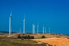 .Power of wind turbine generating electricity clean energy with cloud background on the blue sky.Global ecology.Clean energy. Power of wind turbine generating stock image