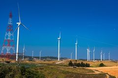 .Power of wind turbine generating electricity clean energy with cloud background on the blue sky.Global ecology.Clean energy. Power of wind turbine generating stock images