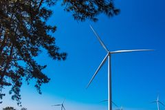 Power of wind turbine generating electricity clean energy with cloud background on the blue sky.Global ecology.Clean energy. Concept save the world stock photos