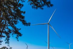 Power of wind turbine generating electricity clean energy with cloud background on the blue sky.Global ecology.Clean energy. Concept save the world country stock photography