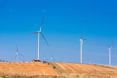Power of wind turbine generating electricity clean energy with cloud background on the blue sky.Global ecology.Clean energy. Concept save the world country royalty free stock photo