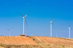 Power of wind turbine generating electricity clean energy with cloud background on the blue sky.Global ecology.Clean energy. Concept save the world country stock photo