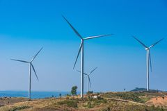 Power of wind turbine generating electricity clean energy with cloud background on the blue sky.Global ecology.Clean energy. Concept save the world stock image