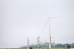 Power of wind turbine generating electricity clean energy with m. Ist fog background.Global ecology.Clean energy concept save the world royalty free stock photos