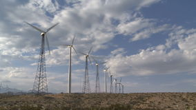 Power Windmills in the California Desert at Sunset. Windmills in Palm Springs California stock video footage