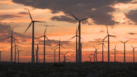 Power Windmills in the California Desert at Sunset. Windmills in Palm Springs California stock video