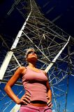 Woman in front of High Voltage Power Lines Stock Photos