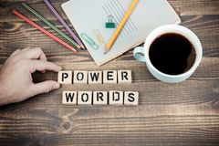 Power Words. Wooden letters on the office desk. Informative and communication background stock image