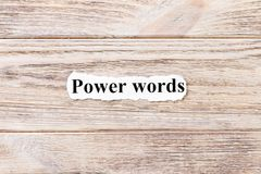 Power of words of the word on paper. concept. Words of power of words on a wooden background.  stock photos