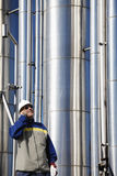 Gas worker and pipelines Stock Photo