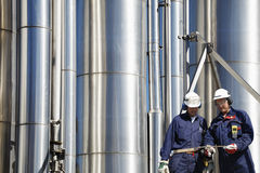 Gas workers and pipelines Stock Photos