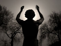 Power Of Worship. A man raises his arms in prayer Royalty Free Stock Photo