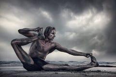 Power Yoga on the beach Royalty Free Stock Photos