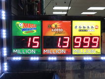 Powerball Jackpot. Photo of powerball jackpot sign at a liquor store in washington dc on 1/13/16. The sign lists the jackpot at 999 million dollars though it is stock photos
