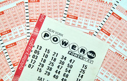 Powerball lottery tickets. MONTREAL, CANADA - DECEMBER 23, 2016 : Powerball New York lottery tickets. Powerball is an American lottery game offered by 44 states Royalty Free Stock Photo