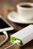 Powerbank charging a smartphone Royalty Free Stock Images