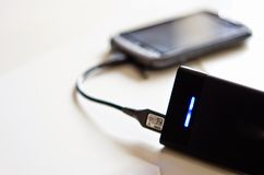 Powerbank on living room table Royalty Free Stock Photography