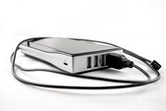 Powerbank noir d'isolement avec le câble branché Photos stock