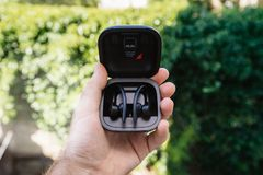 Powerbeats Pro Beats by Dr Dre unboxing package. Paris, France - Jun 17, 2019: Powerbeats Pro Beats by Dr Dre wireless high-performance earphones charging case royalty free stock photo