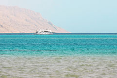 Powerboat. White ship in the blue sea on mountain background in Red Sea Stock Photo