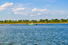 Powerboat floats on the river. The Powerboat floats on the river Royalty Free Stock Photography