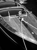 Powerboat Luxury. A luxurious classic antique wooden motor boat runabout Stock Photos