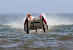 Powerboat racing on ocean Stock Photo
