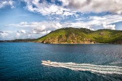 Powerboat travel in blue sea on cloudy sky in gustavia, st.barts. Travel on boat, wanderlust. Summer vacation on. Tropical island. Water transport and vessel stock images