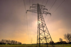 Powercables. Electricity transmission pylon with power cables Royalty Free Stock Images