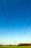 Powercables. Electricity transmission cables with blue sky in the background Stock Photography