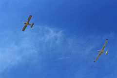 Powered aircraft launching glider Royalty Free Stock Image