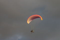 Powered parachute against the dark clouds Royalty Free Stock Images