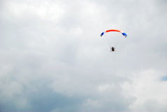 Powered parachute in the cloud Stock Photography