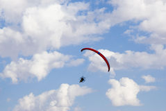 Powered paraglider. A powered paraglider pilot in flight with a cloudy sky in the background Royalty Free Stock Photography