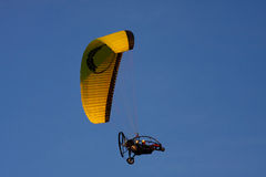 Powered paraglider. In the sky stock images