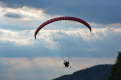 Powered paraglider flying Stock Photo