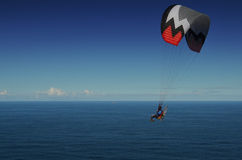 Powered Paraglider Over Ocean Stock Photography