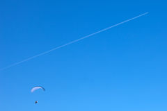 Powered paragliding with a flying plane Stock Image