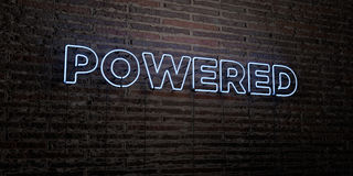 POWERED -Realistic Neon Sign on Brick Wall background - 3D rendered royalty free stock image. Can be used for online banner ads and direct mailers vector illustration
