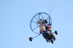 Powered tandem paraglider rear. View Royalty Free Stock Photos