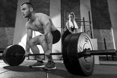 Powerful athletic bodybuilder holding on to the barbell Stock Photo